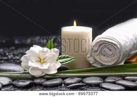 Still life with gardenia flowers with candle ,towel on therapy stones