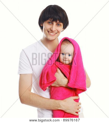 Portrait Of Young Father Holding On Hands Wet Baby In Towel
