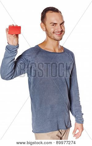 Smiling casual man showing blank credit card