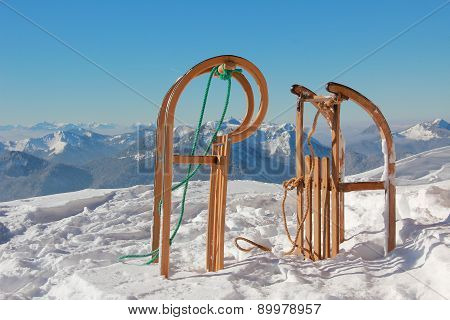 Two Sleds And Wintry Mountain Range