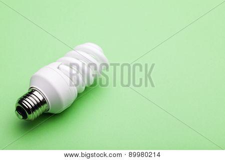 Lightbulb On Green Background