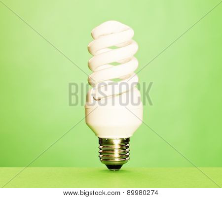 Lightbulb On Green Background