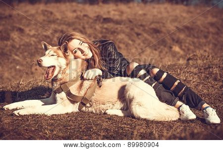 Girl And Her Husky Dog Outdoor In The Forest