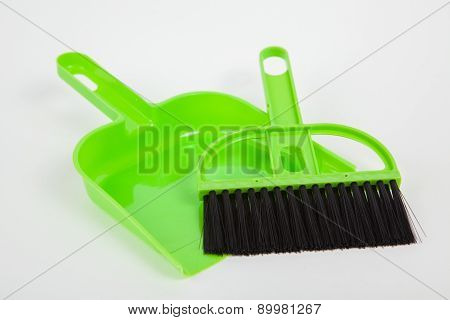 Garbage Scoop And Broom On White Paper Background