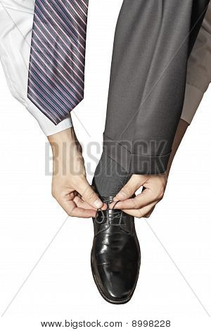 Businessman Tying Shoe Laces