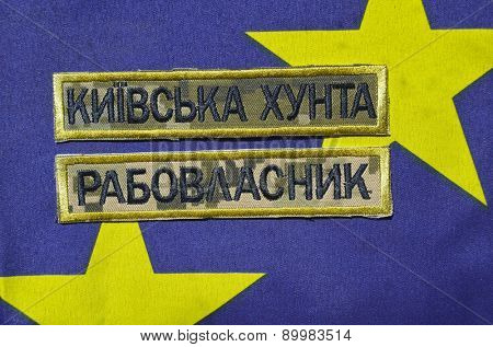 Ukrainian military chevron. With EU Flag as background.on April 16,2015 in Kiev, Ukraine