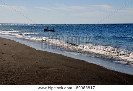 Boat By A Black Sand Beach