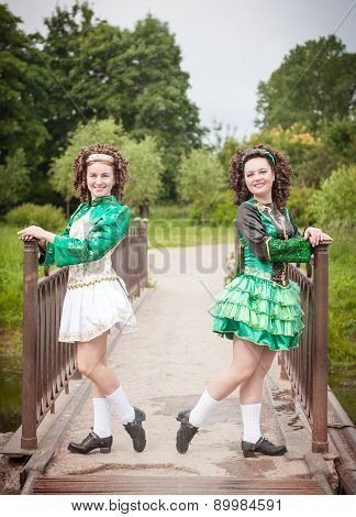 Two Young Beautiful Girl In Irish Dance Dress Posing Outdoor