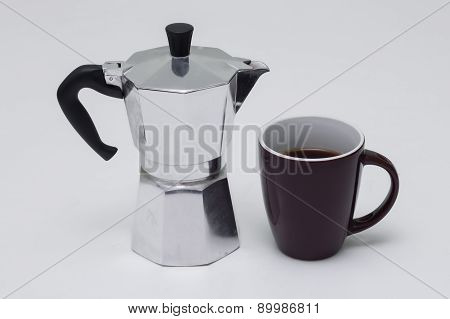 Strong cup of coffee with coffee pot