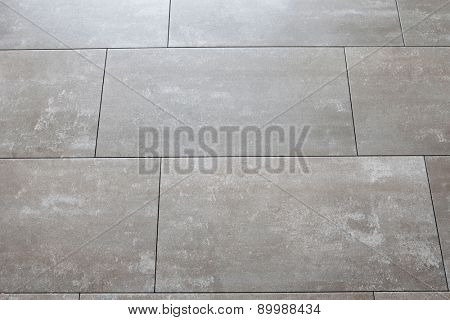 Photo of grey floors with large tile horizontally