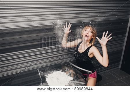 beautiful girl the kitchen hands in flour