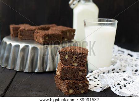 Chocolate Brownies On A Dark Background