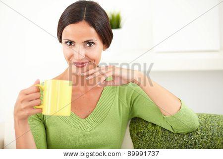 Young Caucasian Woman Holding A Yellow Mug