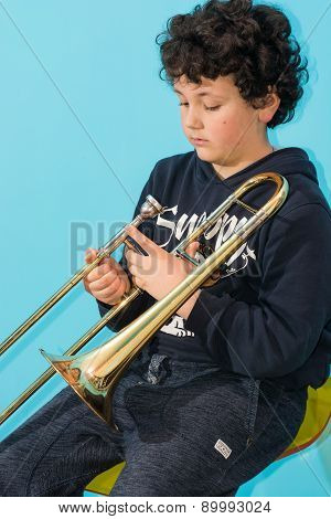 Child Plays The Trombone.
