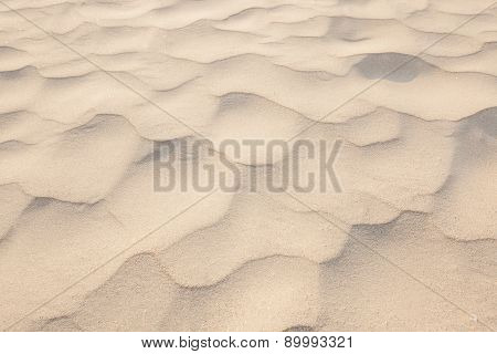 Closeup Of Sand Pattern Of A Beach In The Summer/sand Texture