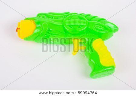 Toy Gun On White Paper Background