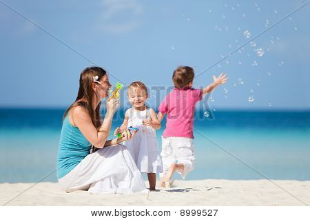 Family Making Soap Bubbles