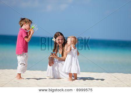 Family Making Soap Bubbles