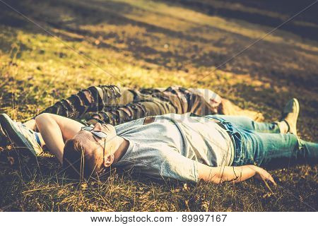 Pretty couple rest outdoor in the forest