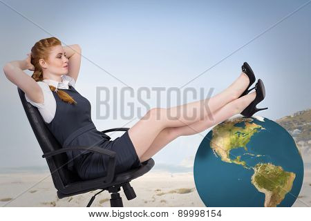 Businesswoman sitting on swivel chair against beautiful beach and blue sky