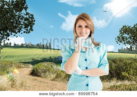 Air hostess against scenic backdrop