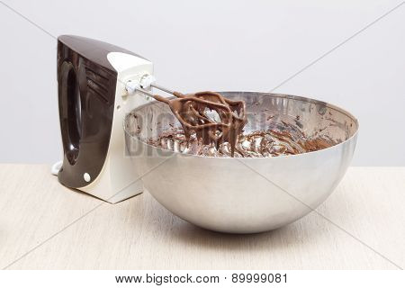 Mixer next to a bowl with chocolate cream