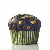 stock photo of chocolate-chip  - High resolution image of chocolate muffin with chocolate chips on white background - JPG