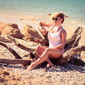 pic of bathing  - Woman with beautiful body on a tropical beach - JPG