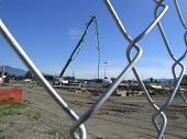 picture of burlington  - concrete pumping truck pours the foundation for yet another fast food restaurant - JPG