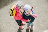 picture of little sister  - little sisters in a park in spring - JPG