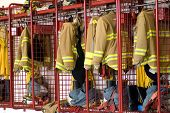 image of firehouse  - fireman coats and boots wait for the next call - JPG