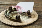 foto of lap  - Vintage horseshoe for good luck on a wicker lap with the card for an inscription - JPG