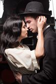 foto of locomotive  - kissing couple on railway station at locomotive background - JPG