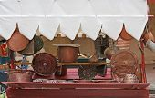 stock photo of flea  - many copper objects for kitchen and home for sale in the antiques stall at flea market - JPG