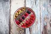 image of berries  - Breakfast berry smoothie bowl topped with goji berries - JPG