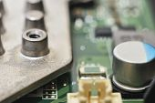 stock photo of capacitor  - macro capacitor on green circuit board background  - JPG