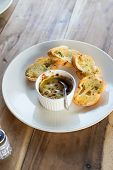 picture of clam  - Baked Clams with garlic bread on white dish - JPG