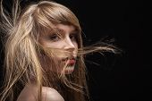 pic of flowing hair  - girl with fluffy flying hair on black background - JPG