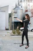 stock photo of handgun  - Beautiful woman with a loaded handgun pistol - JPG