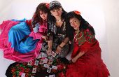 stock photo of gypsy  - Three gypsy women posing in traditional outfits