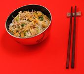 picture of rice noodles  - Vietnamese vermicelli chicken and rice noodles soup pho on a red background - JPG