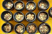 foto of copper coins  - donate Thai coin in Buddhist monk - JPG