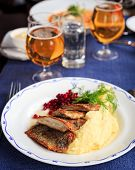 image of potato-field  - Traditional Swedish dish with fried herring and mashed potatoes and lingon berries served with beer photographed with selective focus and shallow depth of field