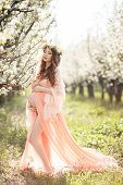 stock photo of chemise  - Young beautiful pregnant woman - JPG