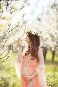 picture of night-blooming  - Young beautiful pregnant woman - JPG