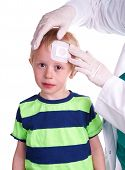 pic of nurse  - Child gets injury on the forehead and the nurse helps with getting plaster on the wound so it can heal - JPG