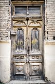 picture of abandoned house  - Ancient cracked door of a abandoned house - JPG