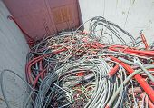 picture of landfills  - containers of hazardous waste landfill full of electrical wires - JPG