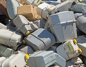 picture of landfills  - bunch of old gas meters in a contaneir of the landfill of hazardous material - JPG