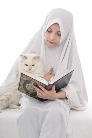 foto of islamic religious holy book  - Pretty Muslim Girl and Cat with Holy Book of Quran Isolated on White Background - JPG
